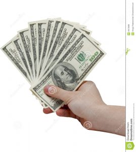 bill of sale for business hand holding stack cash