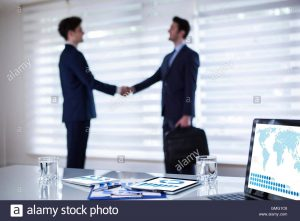 business partnership contract business agreement in office handshake business agreement partnership gmgc