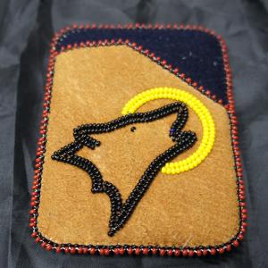 trading card design moose hide card holder howling wolf beaded design